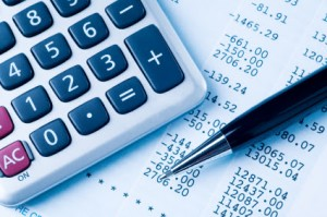 Image Of Calculator And Worksheet For Federal Tax Lawyer - Law Offices of Jerod Gunsberg