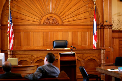 Two lawyers sitting in court who can provide the legal services of the Law Offices of Jerod Gunsberg in Los Angeles, CA
